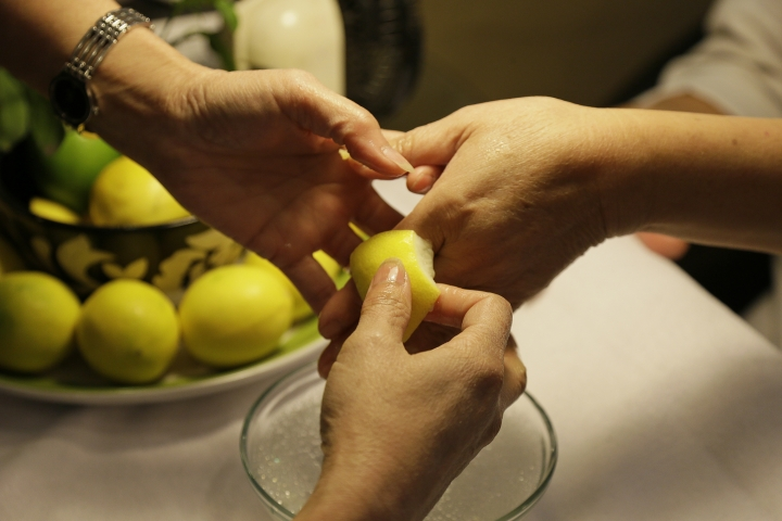 In this Wednesday, Nov. 30, 2016, photo, lemons are used to soften cuticles during a manicure at Leann's Nails in Alameda, Calif. All previous efforts to limit nail-salon workers' exposure to harmful chemicals through legislation failed because of opposition from the chemical and beauty-products industry. But starting in 2010, Bay Area salon workers, immigrant women often with poor English and little idea of their rights, waged a grassroots campaign that has succeeded in establishing a county-health-department certified system of healthy nail salons in California. (AP Photo/Eric Risberg)