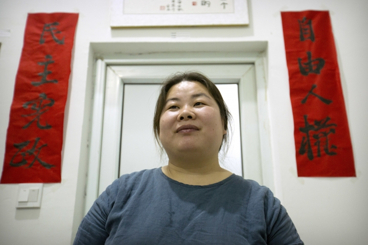 In this Monday, Feb. 27, 2017 photo, Ye Haiyan poses for a photo on in her art studio on the outskirts of Beijing. Ye has resorted to advocating for the rights of sex workers and people with HIV/AIDS through painting after her blogs have been closed down, she has moved from city to city following harassment from authorities, and police told her to leave her latest home ahead of the annual meeting of China's ceremonial parliament that opened Sunday. (AP Photo/Mark Schiefelbein)