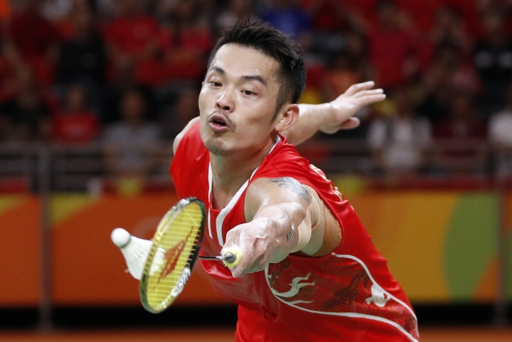FILE- In this Saturday, Aug. 20, 2016 file photo, China's Lin Dan returns a shot to Denmark's Viktor Axelsen during the men's badminton singles bronze medal match at the 2016 Summer Olympics in Rio de Janeiro, Brazil. Lin Dan didn't retire after the Rio de Janeiro Olympics when most observers thought he would. (AP Photo/Vincent Thian, File)