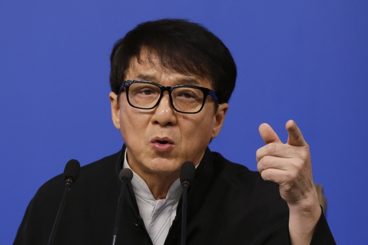 Hong Kong movie star Jackie Chan, delegate to the Chinese People's Political Consultative Conference gestures as he speaks at a press conference on the sideline of the CPPCC at the media center in Beijing, Tuesday, March 7, 2017. Jackie Chan says letting more Hollywood movies into the Chinese market would put pressure on Chinese filmmakers to boost the quality of their domestic output. (AP Photo/Andy Wong)