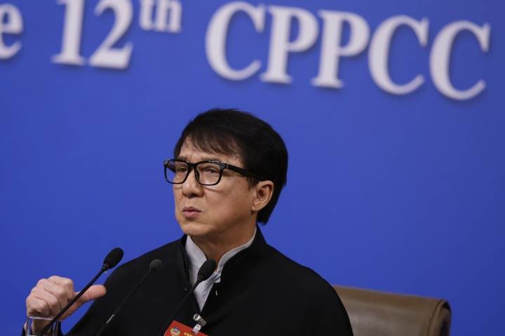 Hong Kong movie star Jackie Chan, delegate to the Chinese People's Political Consultative Conference speaks during a press conference on the sideline of the CPPCC at the media center in Beijing, Tuesday, March 7, 2017. Jackie Chan says letting more Hollywood movies into the Chinese market would put pressure on Chinese filmmakers to boost the quality of their domestic output. (AP Photo/Andy Wong)