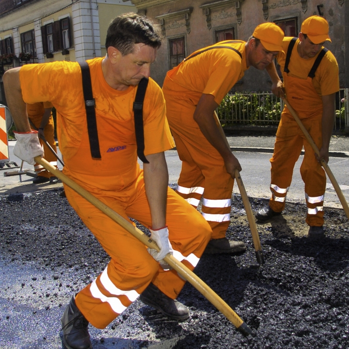 In this photo provided by the Office of the Slovenia's president and used on the president's Instagram, Slovenia's president Borut Pahor, left, takes part in roadworks near Dravograd, Slovenia, July 27, 2012. Donald Trump may rule Twitter, but he's no match for his Slovenian counterpart on Instagram as Slovenia's president Borut Pahor has been actively using social media to get his message across since 2012. (Petra Arsic/Office of the Slovenia's President via AP)