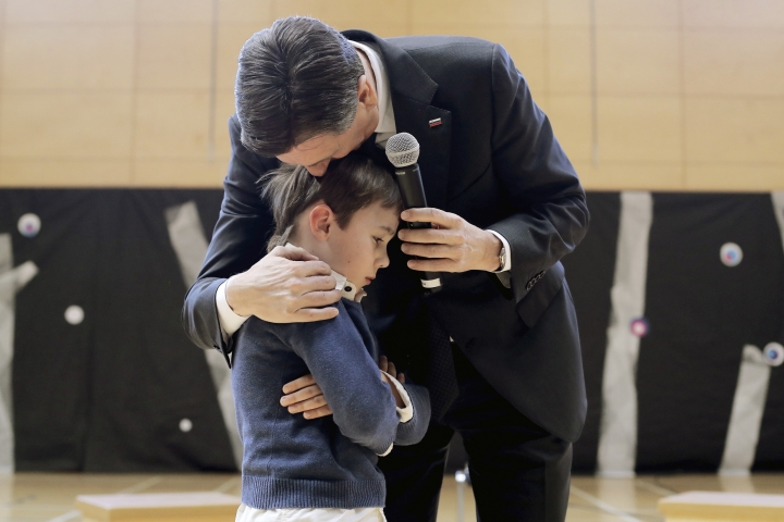 In this photo provided by the Office of the Slovenia's president and used on president's Instagram, Slovenia's president Borut Pahor, consoles a boy who forgot his role during a show at the presidential palace in Ljubljana, Slovenia, Feb. 17, 2015. Donald Trump may rule Twitter, but he's no match for his Slovenian counterpart on Instagram as Slovenia's president Borut Pahor has been actively using social media to get his message across since 2012. (Petra Arsic/Office of the Slovenia's President via AP)
