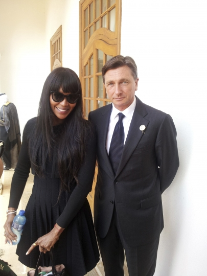 In this photo provided by the Office of the Slovenia's president and used on president's Instagram, Slovenia's president Borut Pahor, right, talks to Naomi Champbell on the occasion of Nelson Mandela funeral, in Johannesburg, South Africa, Dec. 11, 2013. Donald Trump may rule Twitter, but he's no match for his Slovenian counterpart on Instagram as Slovenia's president Borut Pahor has been actively using social media to get his message across since 2012. (Klemen Horvat/Office of the Slovenia's President via AP)