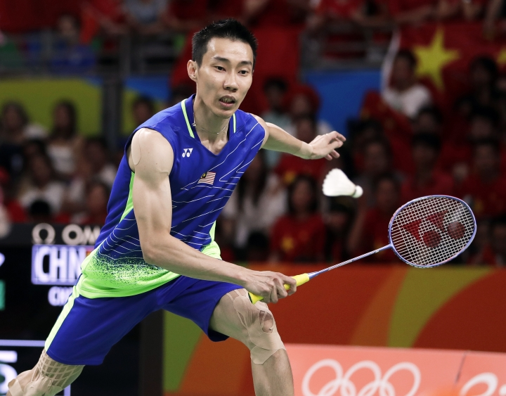 FILE- In this Saturday, Aug. 20, 2016 file photo, Malaysia's Lee Chong Wei returns a shot to China's Chen Long during the men's badminton singles gold medal match at the 2016 Summer Olympics in Rio de Janeiro, Brazil. Lee Chong Wei feared his career was over in a freak accident which tore his knee ligaments during a practice badminton match last month. Still in some pain and not quite 100 percent fit, he starts his 13th and last All Englands on Wednesday, March 8, 2017 against a qualifier. (AP Photo/Kin Cheung, File)
