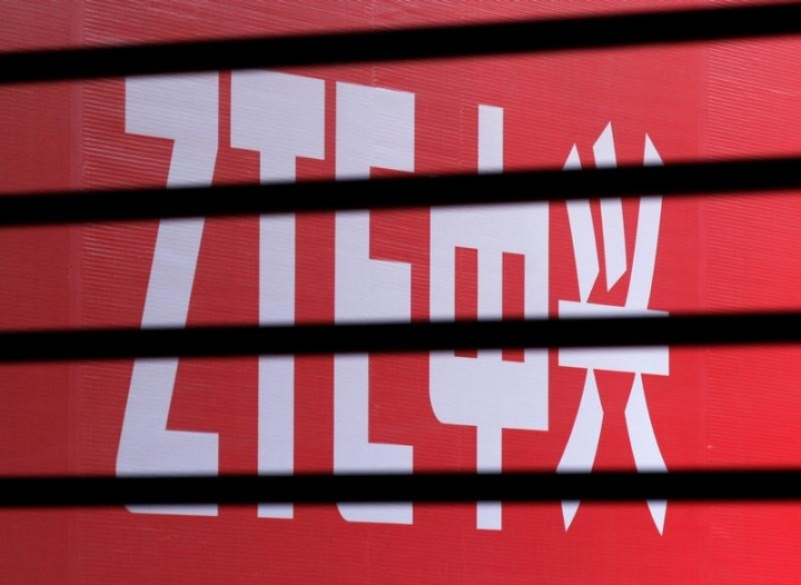 The company logo of ZTE is seen through a wooden fence on a glass door during the company's 15th anniversary celebration in Beijing April 18, 2013.   REUTERS/Barry Huang/File Photo