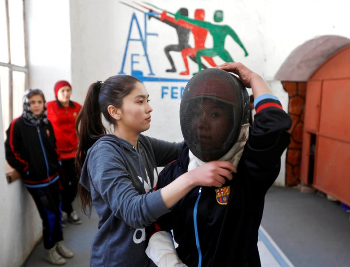 Afghan girls prepare themselves before practicing their daily training at a fencing club in Kabul, Afghanistan March 4, 2017. REUTERS/Omar Sobhani