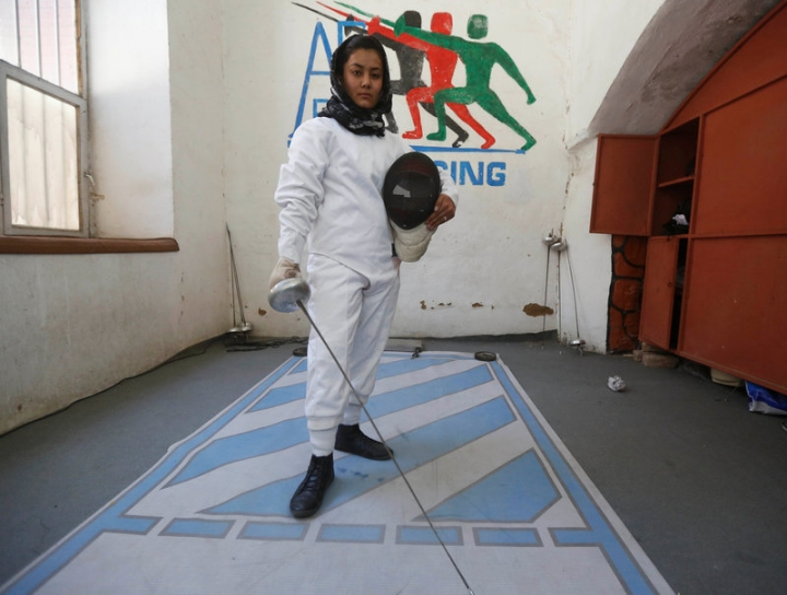 A member of a fencing club poses for photo after their daily training at a Fencing club in Kabul, Afghanistan March 4, 2017. REUTERS/Omar Sobhani