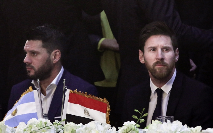 "FILE - In this Tuesday, Feb. 21, 2017, file photo, FC Barcelona's Lionel Messi, right, attends a gala dinner held at the Mena House in Giza, Egypt. Egypt's best known archaeologist has apologized after he angrily called Argentine football superstar Lionel Messi ""an idiot"" because the striker seemed to show little interest during a tour of the Giza Pyramids. (AP Photo/Nariman El-Mofty, File)"