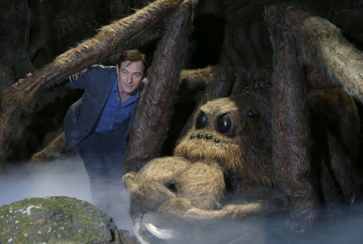 Actor Jason Isaacs poses for the media next to Aragog the Acromantula at a new extension called the 'Forbidden Forest' to the Warner Brothers studio tour 'The Making of Harry Potter' in Watford, England, Wednesday, March 8, 2017. Isaacs played Lucius Malfoy in the popular Harry Potter film series.The attraction will open to the public on March 31. (AP Photo/Alastair Grant)
