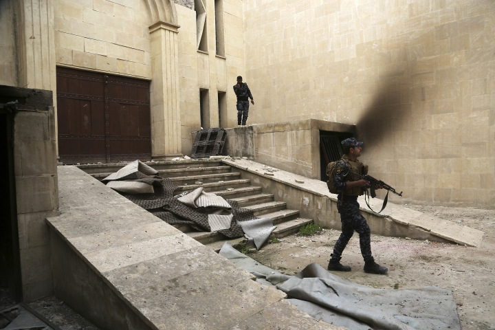 Iraqi federal police inspect Mosul's heavily damaged museum. Most of the artifacts inside the building appeared to be completely destroyed. The basement level that was the museum's library had been burned. The floors were covered in the ashes of ancient manuscripts, in western Mosul, Iraq, Wednesday, March 8, 2017. (AP Photo/Khalid Mohammed)