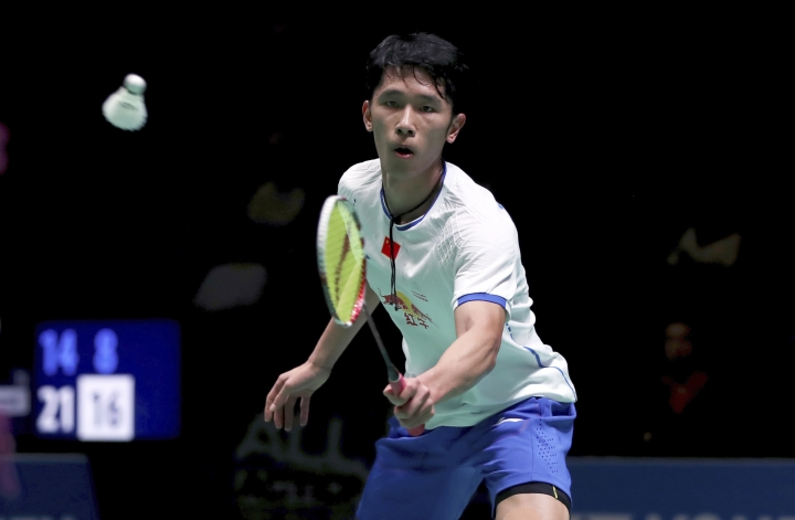 China's Tian Houwei in action against Indonesia's Tommy Sugiarto during round one of the men's singles on day two of the All England Open Badminton Championships in Birmingham, England, Wednesday March 8, 2017. (Simon Cooper/PA via AP)