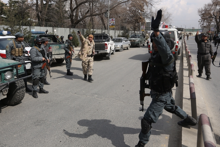 Security forces inspect the site of attack on a military hospital in Kabul, Afghanistan, Wednesday, March 8, 2017. Gunmen stormed the military hospital Wednesday in a neighborhood in the Afghan capital that is also home to a number of embassies. (AP Photo/Rahmat Gul)