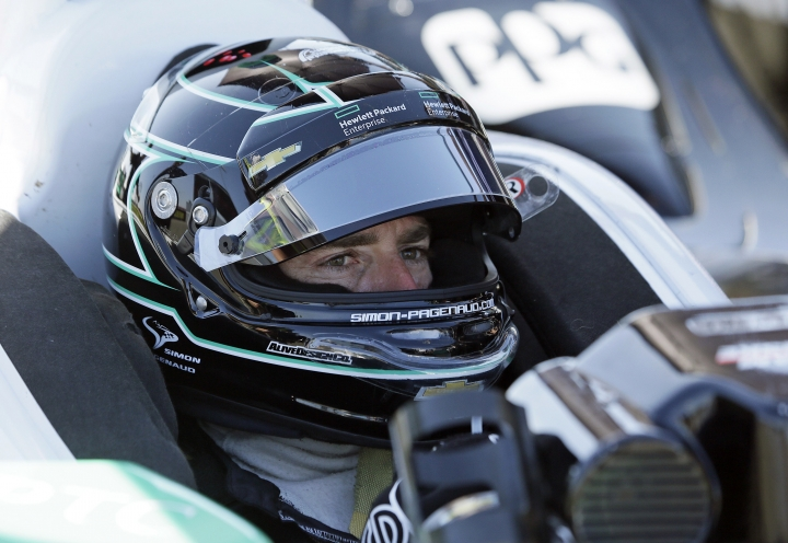 FILE - In this Sept. 17, 2016, file photo, Simon Pagenaud, of France, waits in his car for the start of practice at the IndyCar auto race in Sonoma, Calif. Pagenaud leads a dominant Team Penske squad into IndyCar's season-opening race on Sunday, and the Frenchman has his eye on a second consecutive series championship. (AP Photo/Eric Risberg, File)