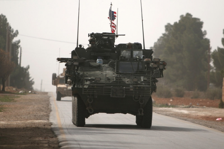 American army vehicles drive north of Manbij city, in Aleppo Governorate, Syria. REUTERS/Rodi Said