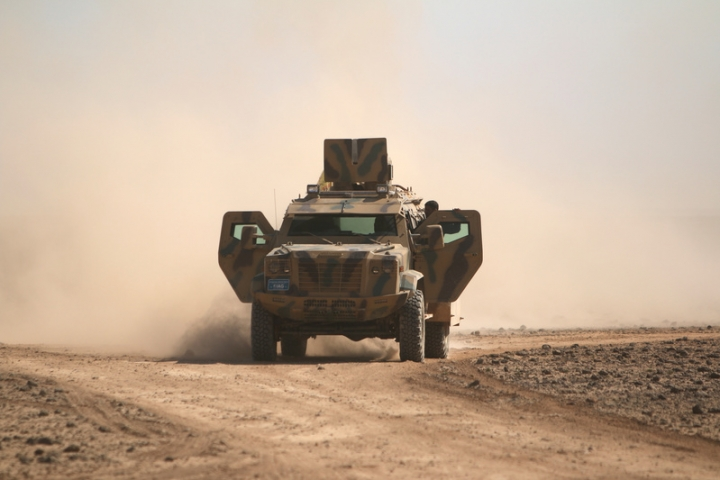 Syrian Democratic Forces fighters ride a military vehicle north of Raqqa city, Syria. REUTERS/Rodi Said