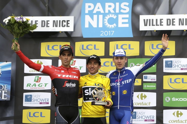 Winner of the Paris-Nice cycling race, Sergio Henao Montoya of Colombia, center, celebrates with second placed Alberto Contador of Spain, left, and third placed Daniel Martin of Ireland on the podium in Nice, southeastern France, Sunday, March 12, 2017. (AP Photo/Claude Paris)