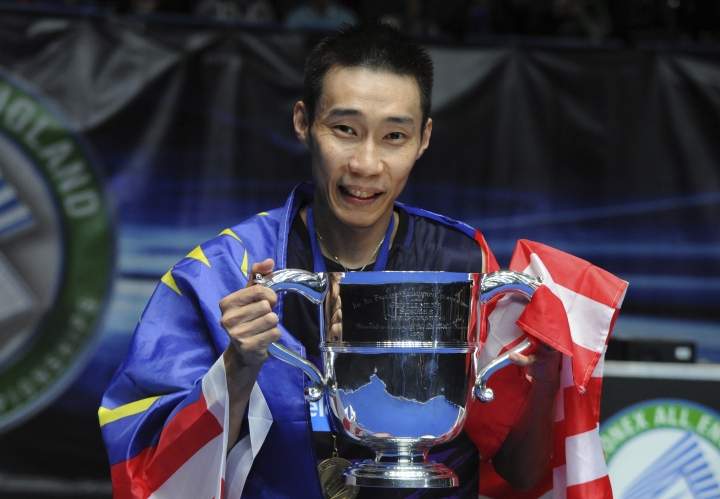 Malaysia's Lee Chong Wei poses for the photographers holding his trophy following the medal ceremony after winning the mens singles final against China's Shi Yuqi at the All England Open Badminton Championships in Birmingham, England, Sunday, March 12, 2017. (AP Photo/Rui Vieira)