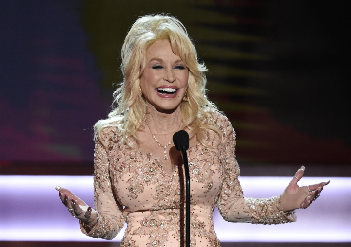 FILE - In this Jan. 29, 2017, file photo, Dolly Parton presents the Lifetime Achievement Award at the 23rd annual Screen Actors Guild Awards at the Shrine Auditorium & Expo Hall in Los Angeles. Parton's My People Fund has issued monthly checks to hundreds of people who lost their homes in deadly wildfires that ravaged East Tennessee in 2016. (Photo by Chris Pizzello/Invision/AP, File)
