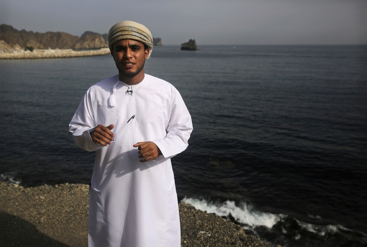 In this Feb. 26, 2017 photo, marine ecologist Ahmad al-Alawi, 26, warns, during an interview on the cliffs above the marina of Bandar al-Rowdha, Oman, that a reoccurring and expanding algae bloom, stretching from India to Oman, threatens the entire marine ecosystem. He says the blooms are growing bigger and lasting longer, displacing the zooplankton at the bottom of the local food chain. (AP Photo/Sam McNeil)