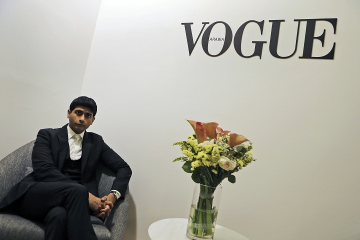 CEO & Publisher of the Vogue Arabia, Shashi Menon poses for the camera at the magazine office at the Dubai Design District in Dubai, United Arab Emirates, Wednesday, March 15, 2017. Vogue launched its 22nd print edition this month in English and Arabic, targeting a niche audience in the Middle East that is fashion conscious, style-driven and wealthy. Vogue Arabia's debut featured on its cover American supermodel Gigi Hadid, whose father is Palestinian, wearing an embellished, mesh veil covering half her face. If the image is anything to go by, the magazine promises to be bold, representative and deferential. (AP Photo/Kamran Jebreili)