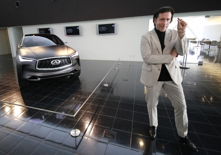 In this Feb. 27, 2017 photo, Nissan's design chief Alfonso Albaisa speaks with an Infiniti Prototype during an interview at the Nissan Technical Center in Atsugi, near Tokyo. Albaisa draws upon the cultures of Japan, America and Cuba in concocting car designs with a flair that once was lacking at Japanese automakers, critics say, but is becoming evident as they globalize. (AP Photo/Shizuo Kambayashi)