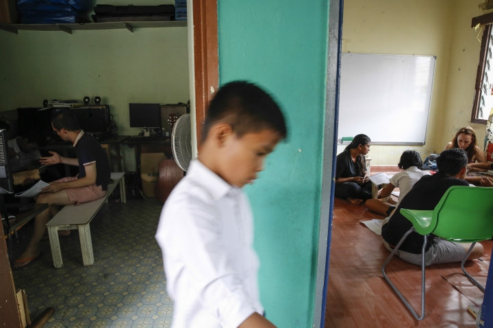 In this March 11, 2017, photo, a Christian Burmese refugee walks between two classrooms during lessons in Kuala Lumpur, Malaysia. An Associated Press analysis suggests that the people hurt most by President Donald Trump's planned deep cuts in refugee visas are from not any of the six Muslim countries listed in his travel ban, but Myanmar. (AP Photo/Joshua Paul)