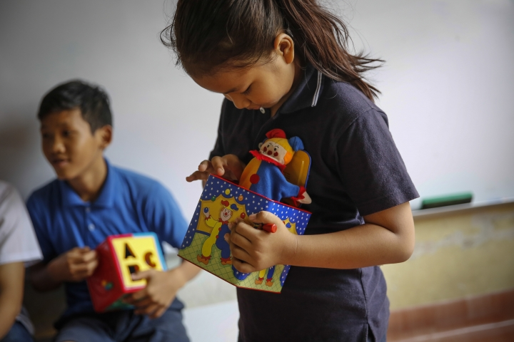 In this March 11, 2017, photo, Christian Burmese refugees play before the start of their lessons in Kuala Lumpur, Malaysia. An Associated Press analysis suggests that the people hurt most by President Donald Trump's planned deep cuts in refugee visas are from not any of the six Muslim countries listed in his travel ban, but Myanmar. (AP Photo/Joshua Paul)