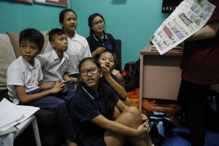 In this March 11, 2017, photo, Christian Burmese refugee students listen to a volunteer teacher during an English lesson in Kuala Lumpur, Malaysia. An Associated Press analysis suggests that the people hurt most by President Donald Trump's planned deep cuts in refugee visas are from not any of the six Muslim countries listed in his travel ban, but Myanmar. (AP Photo/Joshua Paul)
