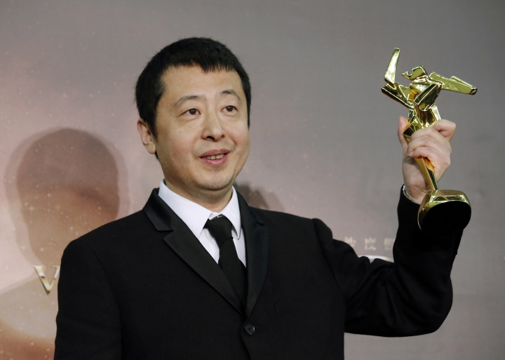FILE - In this March 17, 2016 file photo, Chinese director Jia Zhangke poses after winning the Best Screenplay award of the Asian Film Awards in Macau. Director Jia, known for films exploring China's wrenching social changes, will host his own festival to showcase the work of young directors and movies from developing countries. Jia announced Thursday, March 16, 2017, that the Pingyao International Film Festival will be held Oct. 19-26 in the small city of the same name in the northern province of Shanxi, from where Jia hails. (AP Photo/Kin Cheung, File)