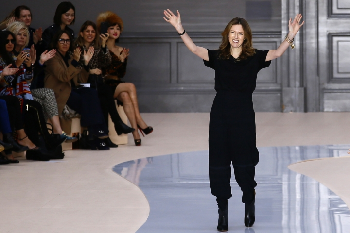 FILE - In this March 2, 2017 file photo, British-born fashion designer Clare Waight Keller acknowledges applause at the end of the presentation of Chloe's Fall-Winter 2017-2018 ready to wear fashion collection, in Paris. Givenchy has announced Thursday March 16, 2017 the appointment of Keller as new designer, signaling a change in artistic direction for the Paris fashion house. (AP Photo/Francois Mori, File)