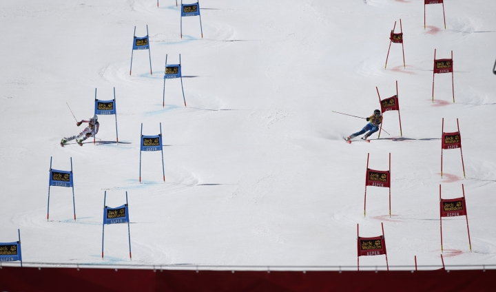 Germany's Lena Duerr, left, competes against Sweden's Frida Hansdotter during a run at a World Cup team event ski race Friday, March 17, 2017, in Aspen, Colo. (AP Photo/Brennan Linsley)
