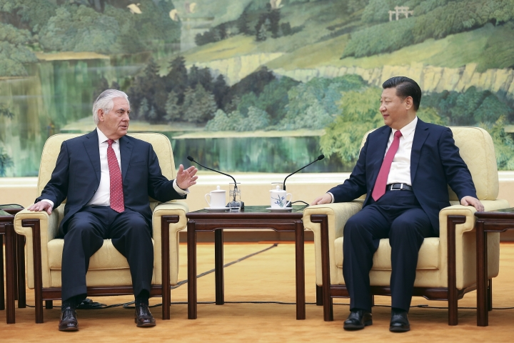 U.S. State of Secretary Rex Tillerson, left, chats with China's President Xi Jinping at the Great Hall of the People in Beijing, China, Sunday, March 19, 2017. (Lintao Zhang/Pool Photo via AP)