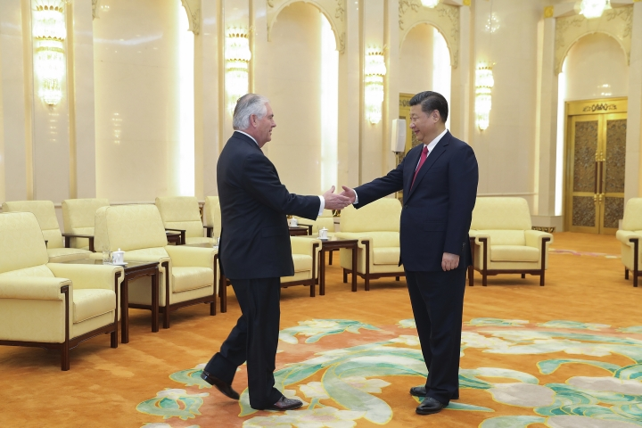 U.S. State of Secretary, Rex Tillerson, left, shakes hands with China's President Xi Jinping at the Great Hall of the People in Beijing, China, March 19, 2017. The United States is looking forward to the first meeting between President Donald Trump and his Chinese counterpart Xi Jinping, Tillerson said Sunday, on the final day of a swing through Asia dominated by concerns over North Korea's nuclear and missile programs. (Lintao Zhang/Pool Photo via AP)