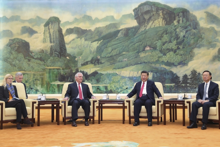 U.S. State of Secretary, Rex Tillerson, center left, attends talks with China's President Xi Jinping, center right, at the Great Hall of the People in Beijing, China, March 19, 2017. The United States is looking forward to the first meeting between President Donald Trump and his Chinese counterpart Xi Jinping, Tillerson said Sunday, on the final day of a swing through Asia dominated by concerns over North Korea's nuclear and missile programs. At left is U.S. Secretary of State's Chief of Staff Margaret Peterlin and at right is China's State Councilor Yang Jiechi. (Lintao Zhang/Pool Photo via AP)