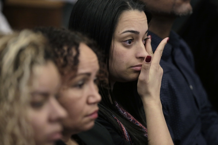 Members of one of the victim's family are tearful during the double murder trial of former New England Patriots tight end Aaron Hernandez at Suffolk Superior Court, Monday, March 20, 2017, in Boston. Hernandez is on trial for the July 2012 killings of Daniel de Abreu and Safiro Furtado who he encountered in a Boston nightclub. The former NFL football player is already serving a life sentence in the 2013 killing of semi-professional football player Odin Lloyd. (AP Photo/Steven Senne, Pool)