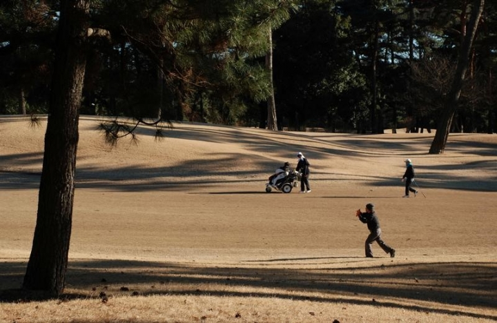FILE PHOTO: People play golf at Kasumigaseki Country Club in Kawagoe, Saitama Prefecture, Japan, January 25, 2017.   REUTERS/Oh Hyun