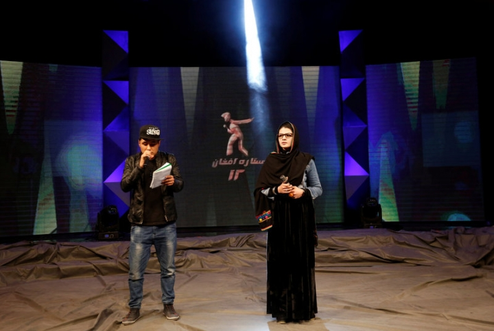 Zulala Hashimi 18 (R) and Sayed Jamal Mubarez 23 (L) singer finalists of the music contest 'Afghan Star', rehearse for the show in Kabul, Afghanistan March 19, 2017.  REUTERS/Mohammad Ismail