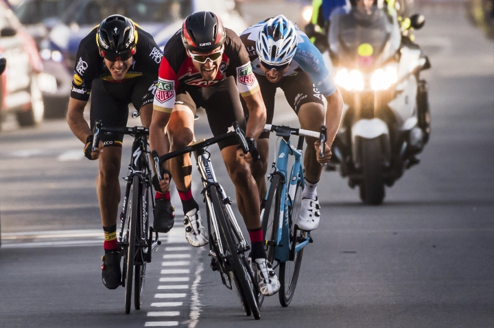 Belgium's Greg Van Avermaet, center, of the BMC Racing Team, sprints to win the E3 Harelbeke cycling race in Harelbeke, Belgium on Friday, March 24, 2017. Olympic road champion Avermaet came out on top of a three-man tactical sprint to win the E3 Harelbeke on Friday as Belgian riders secured a 1-2-3 finish in the one-day cobbled race. (AP Photo/Geert Vanden Wijngaert)