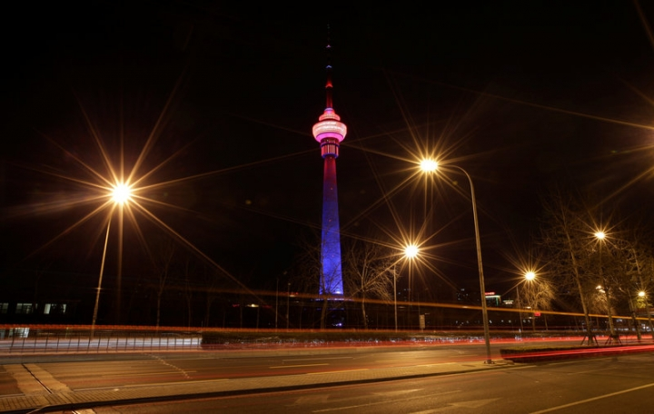 The China Central Radio and Television Tower is pictured before Earth Hour in Beijing, China March 25, 2017. REUTERS/Jason Lee