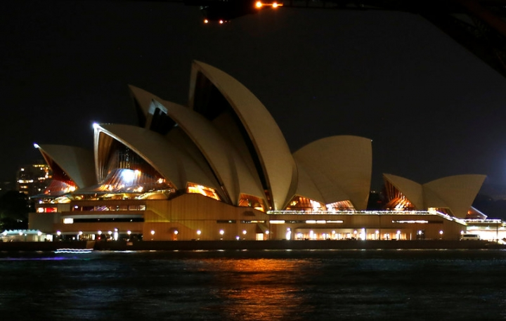 The Sydney Opera House seen during the tenth anniversary of Earth Hour in Sydney, Australia, March 25, 2017.      REUTERS/David Gray