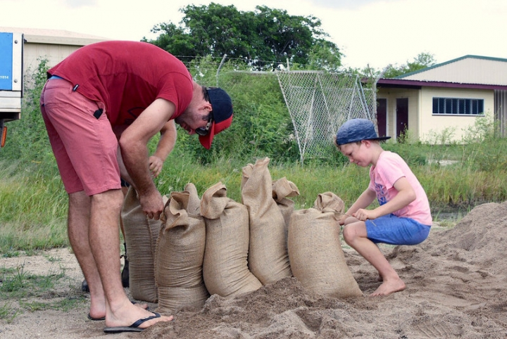 Residents fill sandbags in preparation for the arrival of Cyclone Debbie in the northern Australian town of Bowen, located south of Townsville.     AAP/Sarah Motherwell/via REUTERS