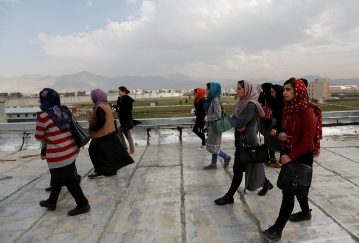 Female students of American University of Afghanistan walk on the roof of a building during a security training and new orientation sessions at a American University in Kabul.    REUTERS/Mohammad Ismail