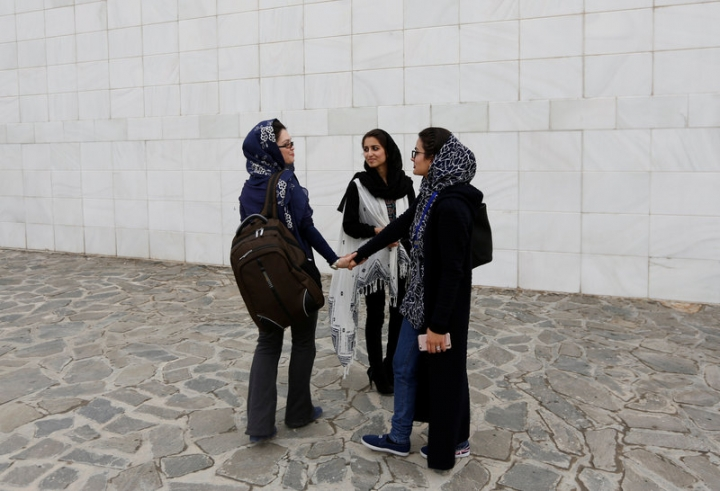 Female students of American University of Afghanistan chat with each other as they arrive for new orientation sessions at a American University in Kabul.    REUTERS/Mohammad Ismail