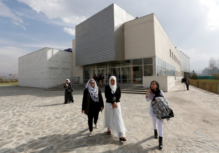 Female students of American University of Afghanistan walk as they arrive for new orientation sessions at a American University in Kabul.    REUTERS/Mohammad Ismail