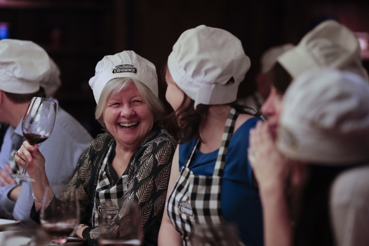"In this March 20, 2017 photo Katherine O'Connor, from Toronto, smiles during an activity called ""The Argentine Experience"" in Buenos Aires, Argentina. Tourists participating in ""The Argentine Experience"" have the chance to learn about the local cuisine, wine and traditions during a dinner in Buenos Aires. (AP Photo/Natacha Pisarenko)"