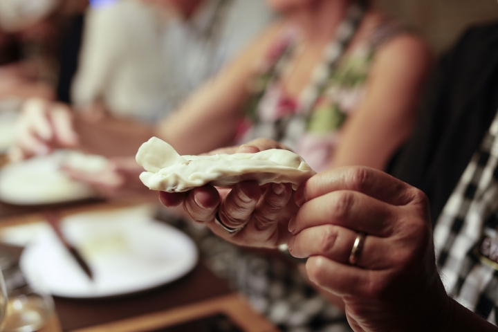 "In this March 20, 2017 photo a tourist makes his own ""empanada"" during an activity called ""The Argentine Experience"" in Buenos Aires, Argentina. Tourists participating in ""The Argentine Experience"" have the chance to learn about the local cuisine, wine and traditions during a dinner in Buenos Aires. (AP Photo/Natacha Pisarenko)"
