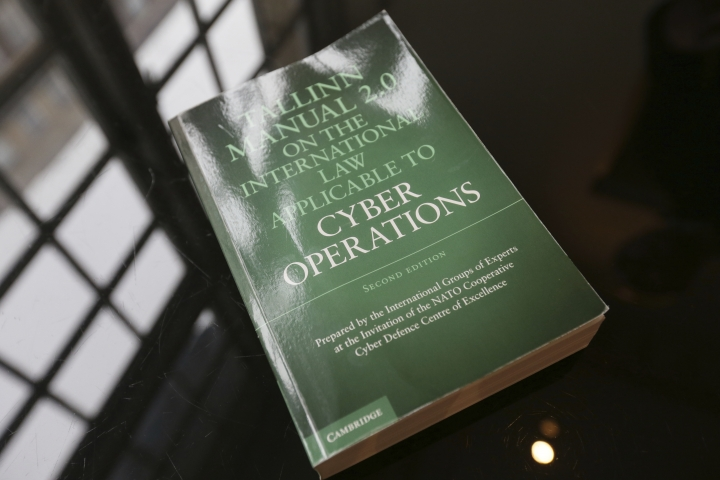 A copy of The Talinn Manual 2.0 at the Victory Services Club, in London, Friday March 24, 2017. The Tallinn Manual 2.0, is a recently published guidebook which Michael Schmitt, a professor of law at the U.S. Naval War College and University of Exeter in England, and others have drawn up to help distinguish this-means-war cyberattacks from more mundane forms of electronic subterfuge. (AP Photo/Tim Ireland)