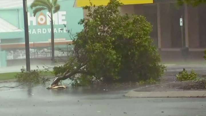 In this image made from video, tree debris lies on the street as wind gusts in Bowen, eastern Australia, Tuesday, March 28, 2017. A powerful cyclone lashed islands, damaged roofs and cut power on Tuesday as it edged toward Australia's tropical northeast coast, officials said.(AuBC via AP)