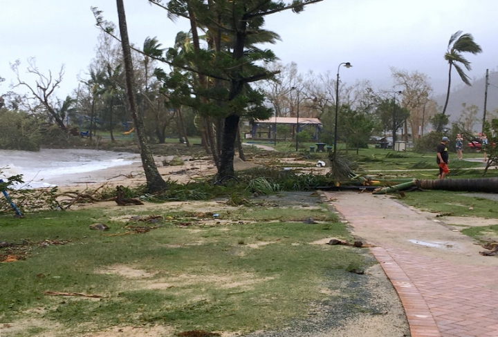 Local residents walk along the damaged foreshore after Cyclone Debbie hit the northern Queensland town of Airlie Beach, located south of Townsville in Australia, March 29, 2017.  Jan Clifford/Handout via REUTERS